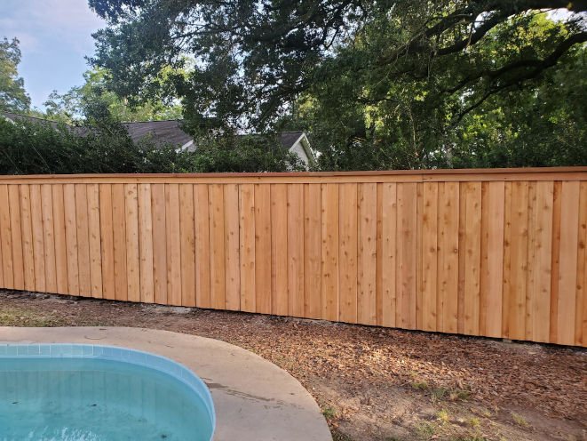 Wood Fence with Board-on-Board Cap Molding