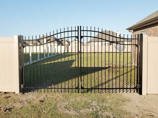 Classic Arched Iron Gate in Waggaman, LA.