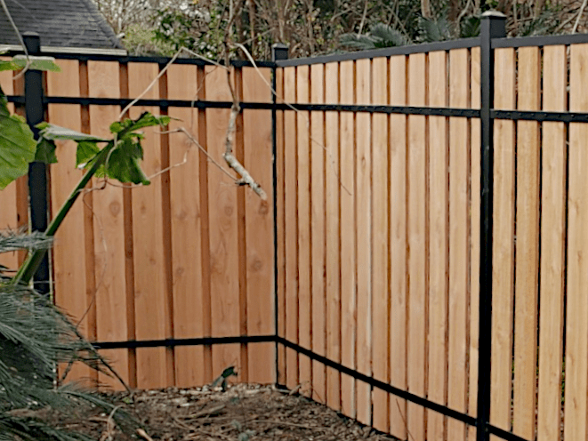 6' High Slip Fence with Cedar Fence Boards and Aluminum Posts. Shadowbox Style with Approximately 90% Privacy.