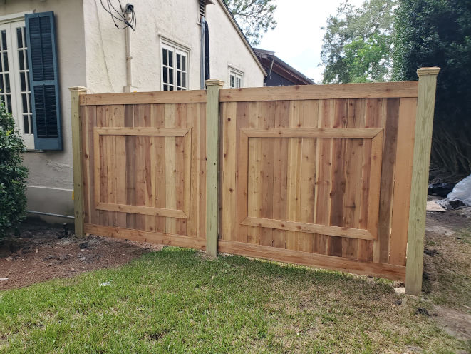 Custom six-foot-high cedar fence in Lakeview with picture frame windows.